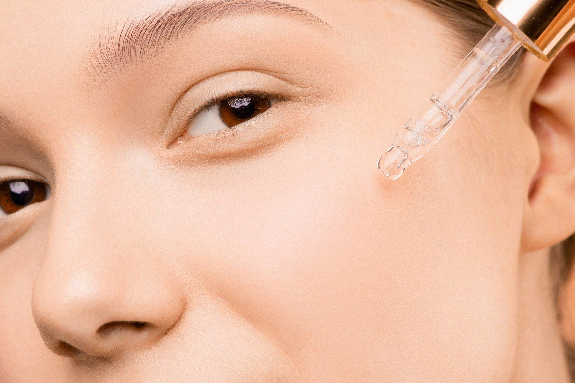 Woman applying a serum