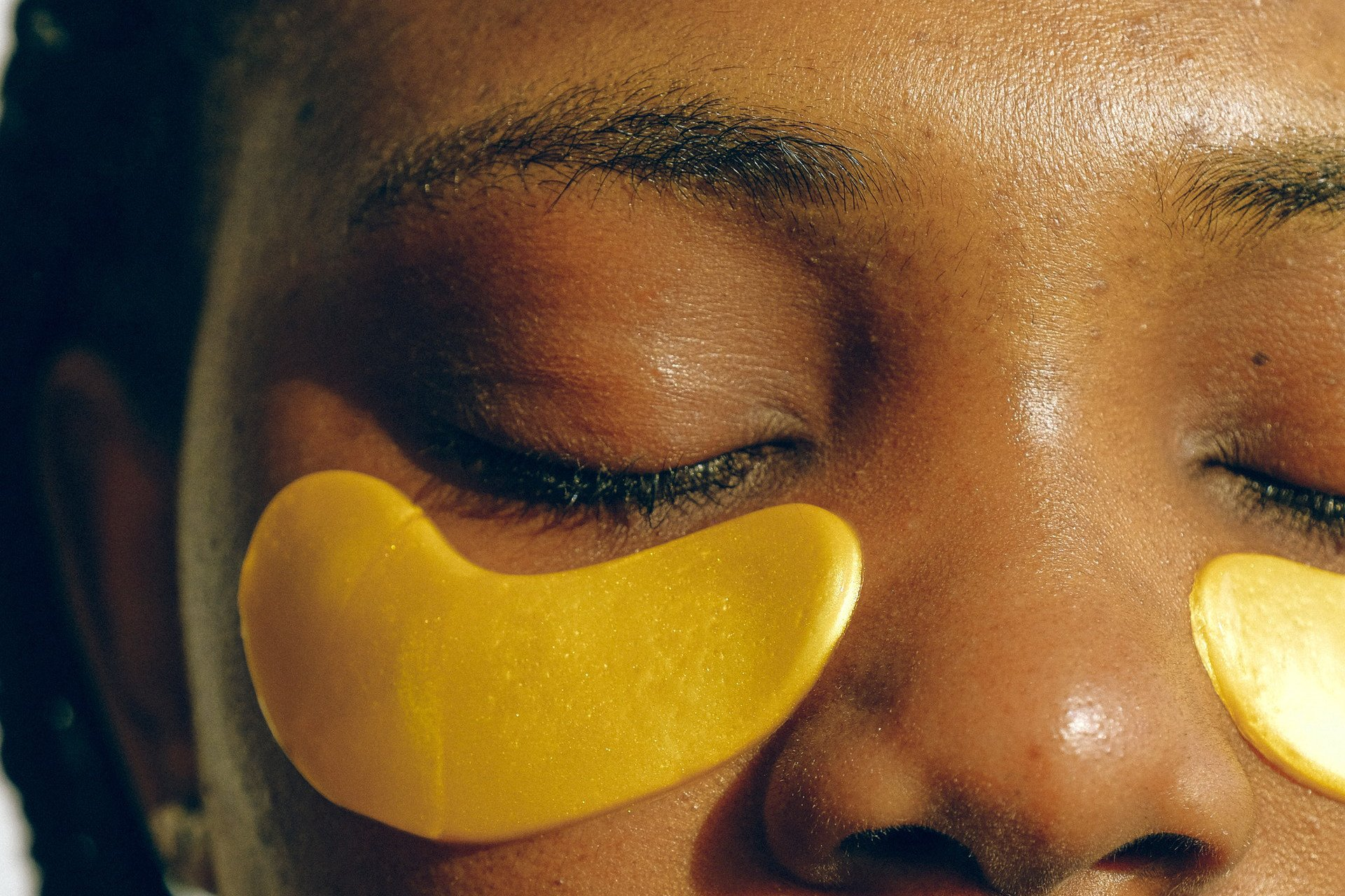 Woman applying eye masks